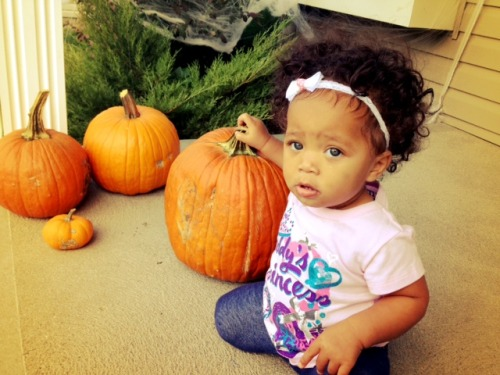Charlotte with pumpkins