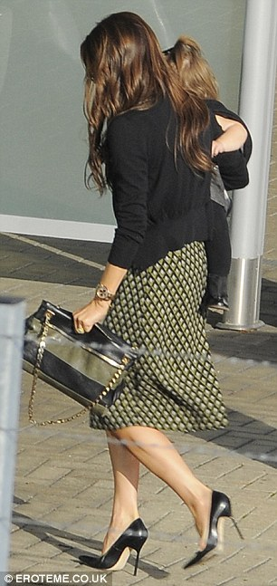 Cardi Girl: Victoria Beckham London Landing