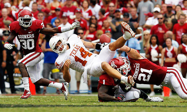 The Red River Rivalry was anything but on Saturday as Oklahoma rolled to a 63-21 victory over Texas. The Longhorns' once-vaunted defense couldn't stop  Sooners backup quarterback Blake Bell, who rushed for four touchdowns. Oklahoma's defense, meanwhile, suffocated Texas quarterback David Ash (pictured) who fumbled once and threw two interceptions. (Tom Pennington/Getty Images) GALLERY: College Football Top 25 Review