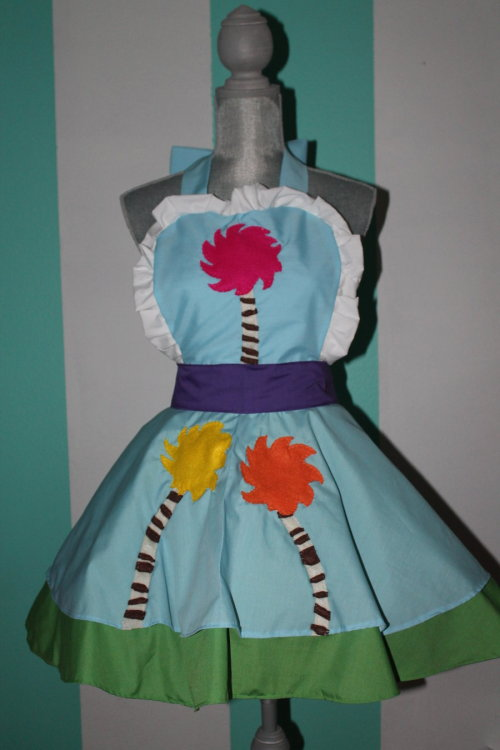 Truffula Tree - The Lorax - Cosplay Pinafore By : Darling Army Woooo. I am way happy with how this pinafore turned out but boy was it frustrating! This was a commission for a lovely girl who is dressing up with her husband who will be the Once-ler for Halloween. We worked together to find a design that she loved and I could provide, but boy was it complicated! Each piece is done in hadncut felt. Each stripe was individually sewn before everything was blanket stitched with nylon quilting thread. it was totally worth it, though. It is breathtaking in-person!  <3