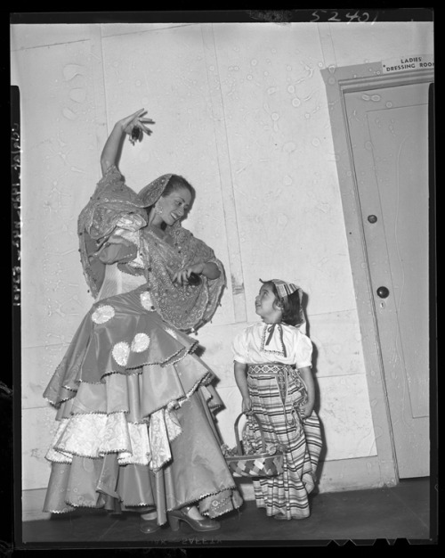 Isabellita Aroza, dancer, and Lupe Franceschi, flower girl, shown at last night's pageant, which told story of Los Angeles' first Independence Day. Los Angeles Times July 3, 1948