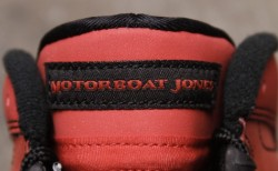 "Air Jordan 9 ""Motorboat Jones"" We have seen them on the feet of celebrities, and glimpses of them as part of the ""Kilroy Pack"", but a detailed look at the Air Jordan 9 ""Motorboat Jones"" shows the all red suede upper wrapped in red 3M. Black hits on the heel, laces, and inner lining combine with the black outsole featuring a white Jumpman symbol to create a clean color palette that will surely turn heads. Specific attributes include ""MOTORBOAT JONES"" replacing the ""AIR JORDAN"" normally stitched on the tongue, and Jones' team, Bilings, and its mascot stitched on the inner portion of the tongue and printed on the insoles. (via Air Jordan 9 ""Motorboat Jones"" 