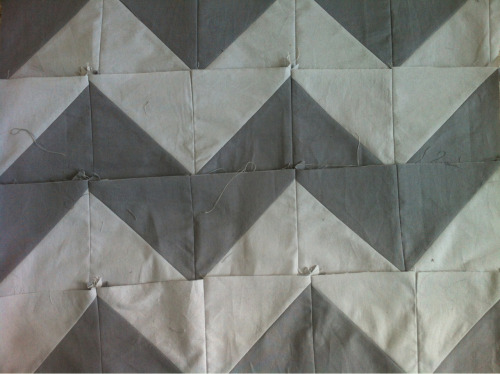 Starting a grey and grey zigzag quilt. I am rotary cutting and machine piecing. It's coming together very quickly!