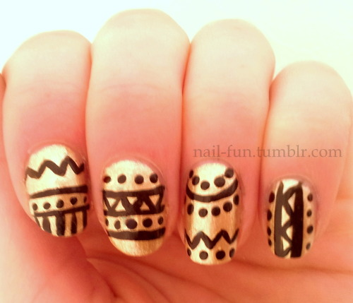 Gold aztec nails