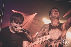 emmadeariephotography:  so last night Austin stole Aaron's microphone to point towards the crowd, so when it was time for his vocals this happened. Emma Dearie Photography