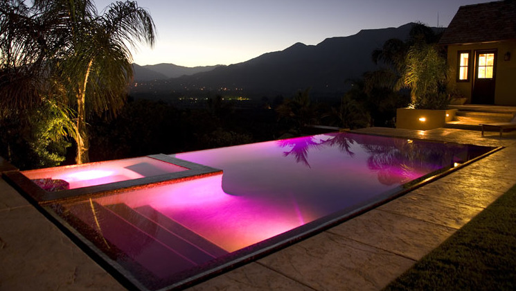 A pink pool created by lights not tile or plaster. Located in Ojai, California, No garden designer was mentioned. The house was designed by Sterling-Huddleson Architects.