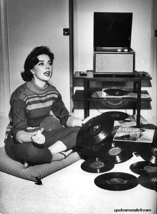 Natalie Wood with her Elvis records, by Murray Garrett