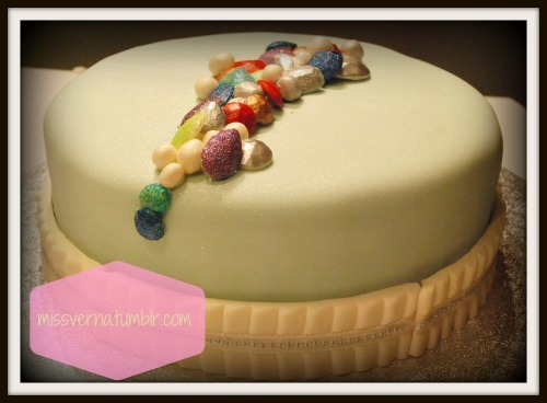 A cake with jewels for a sweet little gem. Made all these jewels with fondant covered in disco sparkle dust!