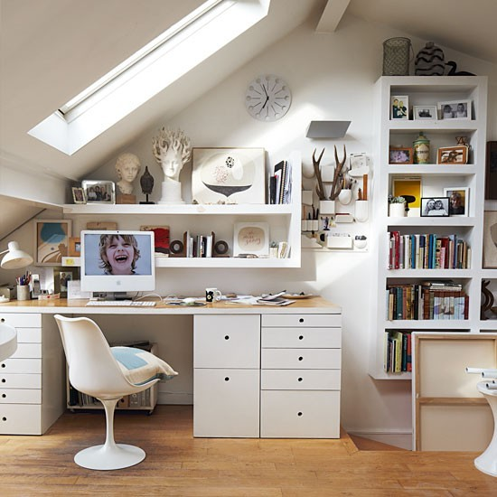 Loft converted into a home office in North London.  Another example of not very minimal, but, very functional and well established.