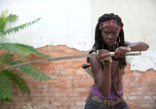 "Badass ""The Walking Dead"" newbie Danai Gurira fills us in on her hotly-anticipated sword swinging character.   How do you get into character as Michonne?She requires a lot of intensity. I'm a pretty intense chick, but she requires all cylinders to fire. You have to get there for her. One mustn't reveal all one's mysterious means, but there are definitely ways I connect with who she is. Mainly it's a lot of yoga, but whatever physical thing I need to do to get my body alive for her."