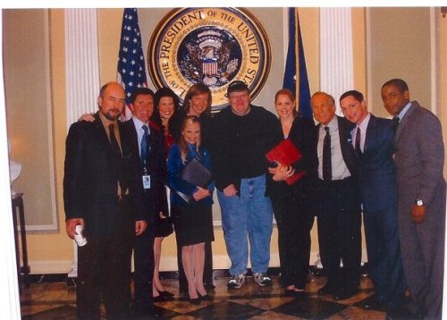 Posing for a group photo on the set with Michael Moore, circa 2004-05. From William Duffy's Facebook page.