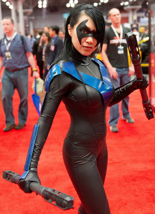 riddlerfotografia:  sparrowsabre7:  Awesome Nightwing cosplay. I didn't use one of the photos from her deviant art because there weren't any with the awesome escrima sticks. Link is below though. http://vampbeauty.deviantart.com/  I would love to meet this Nightwing cosplayer one of these days. Truly inspiring costume and prop work. Love it all!