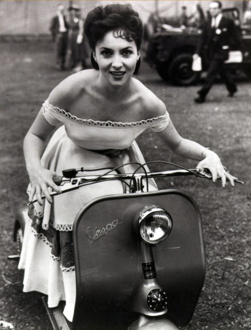 drunkcle:  Gina Lollobrigida spent several days in England in June of 1952, supposedly to promote the Italian Film Industry. What she really did was terrorize the uptight locals with her off-the-shoulder dresses and her sexy Vespa. Bless her.