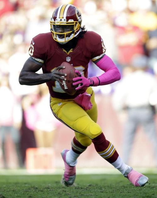 Robert Griffin III runs, throws Redskins past Vikings