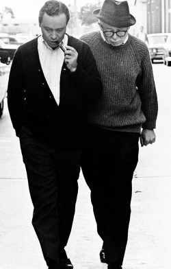 Jack Lemmon and Billy Wilder walk around the lot while filming Irma la Douce, 1963.