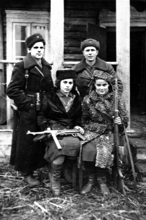 Jewish partisans during World War II. That is photographer Faye Schulman on the bottom right. (via)