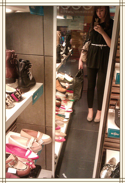 "me in the huge chinese shopping place ""fashion lady"" in nanjing. way too many choices in shoes!"