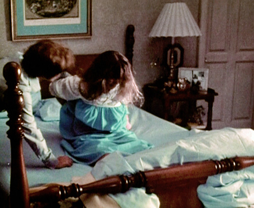 Ellen Burstyn consoles a distressed Linda Blair on the set of The Exorcist after a rig around her midriff, which lifted her off the bed to create the illusion of a demonic attack, came loose and damaged her back.