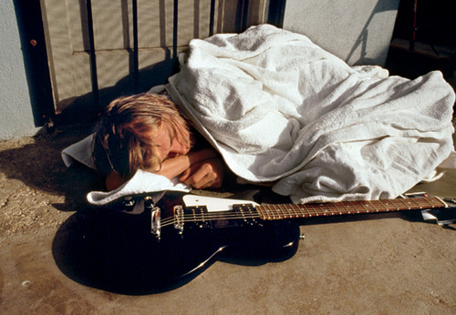 dailykurtcobain:  Kurt Cobain asleep after the underwater shoot of Nirvana for Nevermind. Kurt didn't feel well that day.