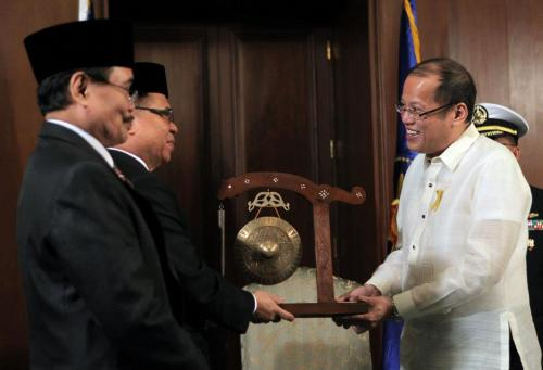 "President Benigno S. Aquino III (right) receives the Gong of Peace from Moro Islamic Liberation Front (MILF) Chairman Al Haj Murad Ebrahim (center) at the Palace Music Room. With the MILF Chairman was MILF Peace Panel Chair Mohagher Iqbal.  MILF Chairman Al Haj Murad Ebrahim met with President Aquino before the signing of the Framework Agreement on the Bangsamoro this afternoon, a landmark in the peace process between the Government of the Philippines and the Moro Islamic Liberation Front. (Photo by Malacañang Photo Bureau) Learn more about the Framework Agreement here: http://www.gov.ph/the-2012-framework-agreement-on-the-bangsamoro/  ""Assalamu alaikum wahrahmatullahi wa barakatu."" The peace, blessings, and mercy of the Almighty be unto you - a phrase I often hear then from radio anchors on early morning shows in Mindanao. And a phrase which captures the essence of the historic moment in Malacanang. May the Framework Agreement usher in a just and enduring peace in Mindanao. Kalinaw Mindanao."