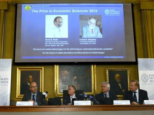breakingnews:  2 Americans win Nobel economics prize AP:Alvin Roth and Lloyd Shapely have won the Nobel economics prize for the theory of stable allocations and the practice of market design.  'Even though these two researchers worked independently of one another, the combination of Shapley's basic theory and Roth's empirical investigations, experiments and practical design has generated a flourishing field of research and improved the performance of many markets,' the academy says. Photo: Representatives of the Swedish Royal Academy of Sciences present the winners of the Nobel Memorial Prize in Economic Sciences on Monday in Stockholm. (Henrik Montgomery / AP)  In which two economists get lumped together because someone important thought their work was similar.