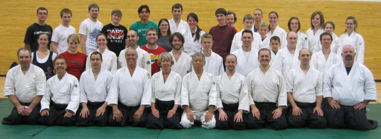 Photo from James Nakayama Sensei Seminar in Logan, UT hosted by Jyushinkan Dojo. Aikido students gathered in Logan, Utah last weekend for Jyushinkan Dojo's annual seminar instructed by James Nakayama Sensei. In addition to AAA members from Logan, Salt Lake City and Orem, visitors representing the California Aikido Association (CAA) joined us from Idaho Falls, ID, Salt Lake City and Mount Pleasant, UT, and a Capital Aikido Federation member traveled from Jackson Hole, WY. On Friday night, several brand new students from Ron Sims Sensei's Utah State University aikido class participated. Nakayama Sensei focused on the modular nature of aikido movement, emphasizing for the beginners how movements, once learned, could be recycled and used in other techniques.