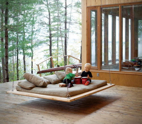 Barnwood hanging bed The suspended bed can be used in both indoor and outdoor environments, making it great for the bedroom or the patio out back. The bed itself does not come with a mattress, just the wooden frame and the chains, although it is noted that professional installation is recommended for the bed. You can have on delivered to your home just in time for the holidays from Anthroplogie.