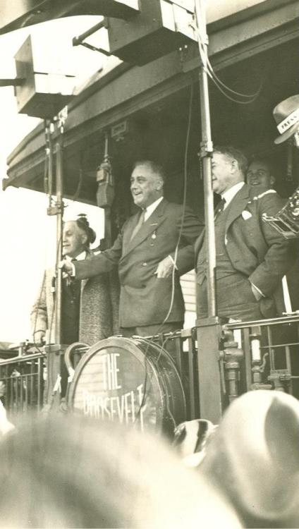 "Franklin D. Roosevelt Whistle Stop Tour, Campaigning aboard train ""The Roosevelt Special"" with son, James at New Albany, Indiana. October 22, 1932. -from the Franklin D. Roosevelt Library."