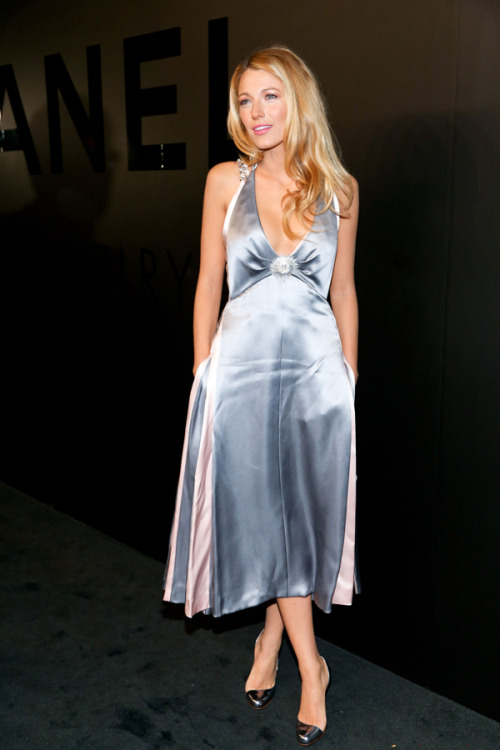 People watching: Blake Lively shines in a glamorous pale blue dress by Chanel and sleek silver pumps from Christian Louboutin. Learn more about her look here »