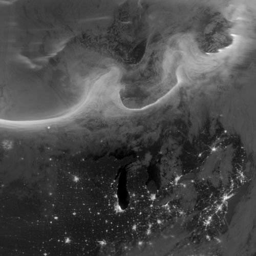 ikenbot:  Aerial View of Aurora over Canada A large coronal mass ejection erupted from the sun Oct. 4-5, 2012, hurling energetic particles into the Earth's magnetosphere, producing many beautiful auroral displays on Earth. Credit: NASA Earth Observatory image by Jesse Allen and Robert Simmon, using VIIRS Day-Night Band data from the Suomi National Polar-orbiting Partnership (Suomi NPP) and the University of Wisconsin's Community Satellite Processing Package The view from space was equally spectacular. The Suomi National Polar-orbiting Partnership (Suomi NPP) satellite acquired this view of the aurora borealis on October 8, 2012. The northern lights float above the Canadian provinces of Quebec and Ontario in this image. Hudson Bay appears as a dark patch at top center. Lake Michigan clearly stands out darkly in the lower center, with the lights of Chicago, IL, on the southern tip. Bright lights sharply define the northeastern megalopolis of the United States at lower right, including Long Island jutting out into the ocean. Montreal, Canada, shines as a bright spot near the right side just below center. — Tom Chao of Space