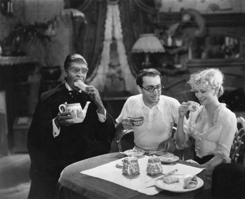 idontknowart:  Lunch with Mr. Hyde Behind the scenes of 'Dr Jekyll and Mr Hyde' (1931) (via Monster Vision) - Frederic March, director Rouben Mamoulian and Miriam Hopkins.
