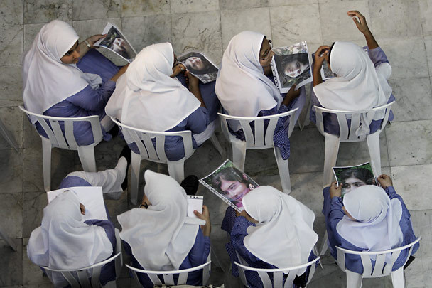 Pakistani schoolgirls pass out photos of Malala Yousafzai.  Yousafzai, who is fourteen, was shot by Taliban forces for being an outspoken proponent of education for women.  Photo by Kamran Jebreili, AP. Yousafzai has been airlifted to the UK for treatment.