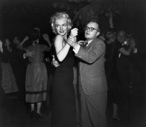 NEW YORK.1955. MARILYN DANCING WITH AN AWKWARD TRUMAN.
