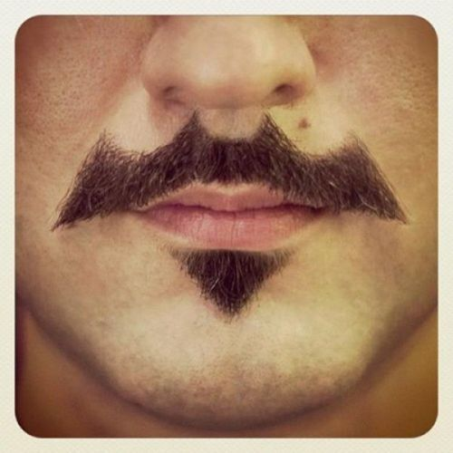 The bat-stache is the facial hair Gotham needs Via