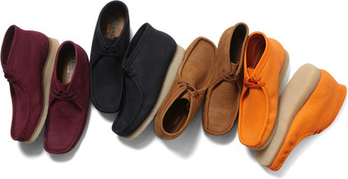 Supreme x Clarks: Following their string of successful collaborations Supreme teams up with Clarks to release a new version of the Wallabee. The shoe is comes in premium nubuck suede with debossed crocodile pattern. Available in-store in NY, LA and London on  Oct 18th, and in Japan Oct. 20th
