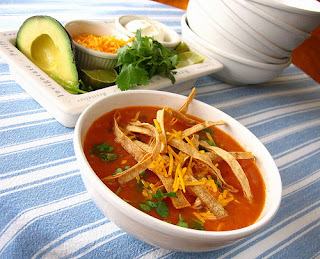 Spicy Tortilla Soup    This delicious Tortilla Soup is great on a cool night, add a side of Homemade Buttermilk Cornbread and you will have a meal. If you do not like it too spicy, cut back on the jalapeño or omit it. You may use a store bought cooked chicken to make this quick and easy.