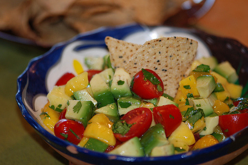 Avocado Mango Salsa Avocado Mango Salsa is a sweet and hot salsa with tangy mangoes and habanero peppers. It is great served with pork, chicken, fish, burgers, as a side dish or just with your favorite chips. If you do not like spicy, omit the habaneros and add red bell peppers. You may use jalapeños in place of the habanero for a less spicy salsa.