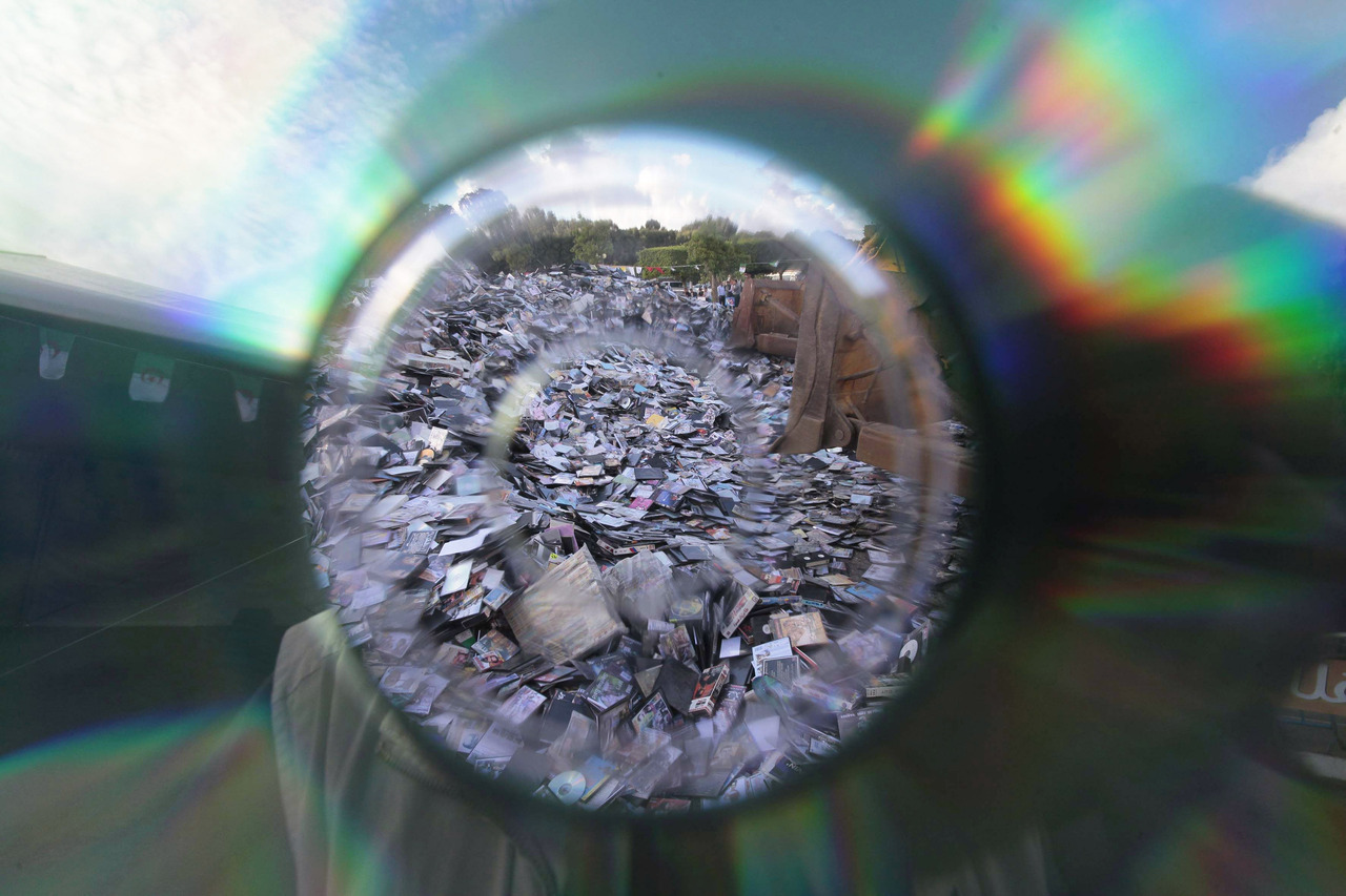 Pirated CDs and DVDs seen through the hole of a CD during a campaign against piracy in Algiers October 15, 2012. Over one million pirated movie, music and software CDs and DVDs seized in recent police operations were destroyed in a campaign organised by the government. [REUTERS/Ramzi Boudina] NEW: Follow Reuters Pictures on Tumblr