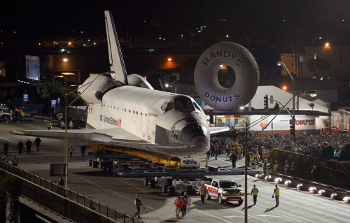 Endeavour makes an evening donut run in Los Angeles. Like you do. (photo by Mark Terrill) Many more here.