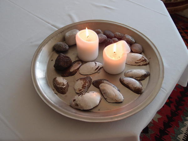 So easy to put together a dish of shells and rocks with candles as a centerpiece or as an accent anywhere in the kitchen for a decorative touch whether entertaining or just for you. Everyone ends up in the kitchen-ditch the candle jars and make an organic arrangement.