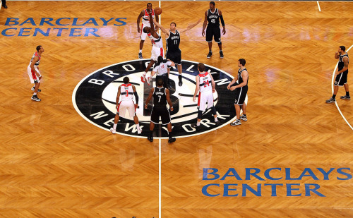 nba:  Brook Lopez of the Brooklyn Nets takes the opening tip off against Emeka Okafor #50 of the Washington Wizards during the a preseason game at the Barclays Center on October 15, 2012 in the Brooklyn borough of New York City. (Photo by Alex Trautwig/Getty Images)