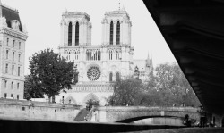 Notre Dame de Paris from under the street and along the Seine River.