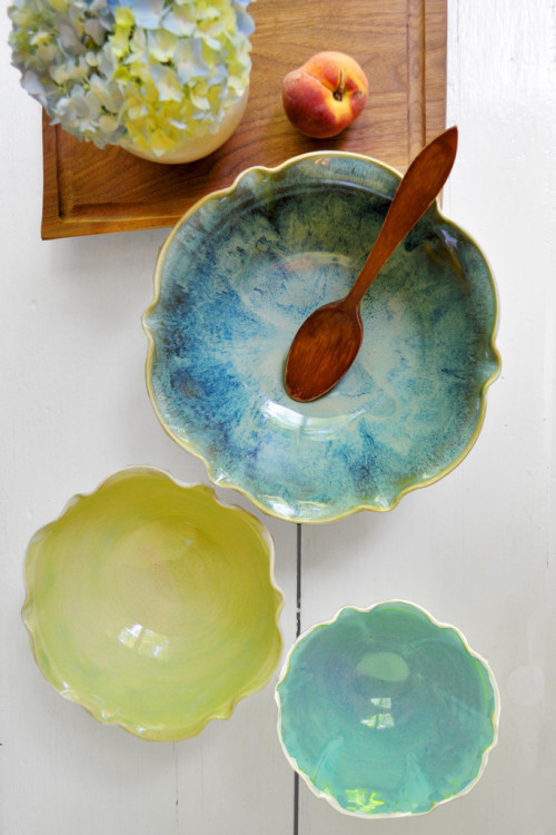 Handmade flower bowls in turquoise, lime and seafoam glaze. I love the imperfections of the glaze mixed with the symmetry of the form. They'd go great with my dinner set, too! By Lee Wolfe Pottery.