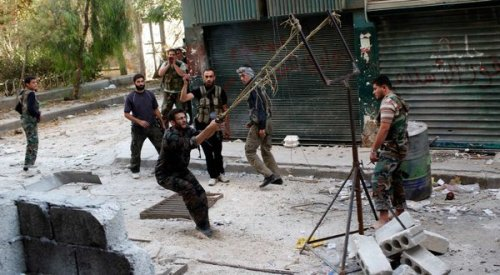 Free Syrian Army fighters launched explosives with a slingshot Tuesday in Aleppo. Rebels now also have more powerful weapons. story here