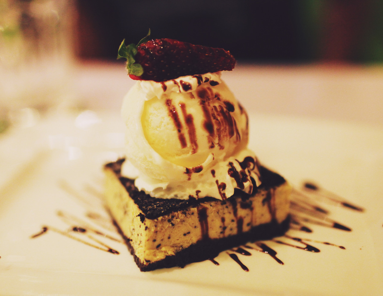 Coriander's Oreo Oreo  Oreo cheesecake served with chocolate sauce and strawberries topped with vanilla ice-cream.