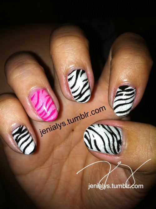 zebra nails :) with pink accent nail! :))  P.S. the black dots that looks like stain/smudging is not smudge! :)) it's holographic glitter that the camera did not pick up :(