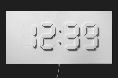 D/A Clock New York City based designer Alvin Aronson has created this beautiful and unique digital wall clock. Measuring (h)500 x (w)1000 x (d)100 mm, the D/A Clock is made from DuPont Corian and steel mechanics.