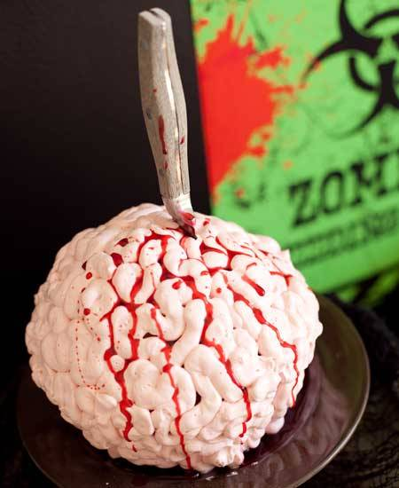 This Zombie Brain Halloween Cake, made of red velvet cake, buttercream, and edible blood, is a delicious dessert that's perfect for your upcoming Halloween party!