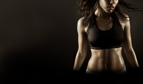 Top 10 Fitness Myths You May Be Falling For: 1. Women Shouldn't Lift Weights Because They'll Bulk Up This is a very real fear for most women. They fear that lifting weights will bulk them up and make them look manly. Fortunately, these fears are unfounded. Women lack comparable amounts of the important muscle building hormone – testosterone. Because of this, it makes it more difficult to put on muscle. The pictures you see of women that are starting to take on the characteristics of men are usually on hormones. For the average female, lifting weights does a body good. 2. You Burn the Most Fat in the Fat Burning Zone This fitness myth is finally dying a slow death. There was always so much confusion with this because you do in fact burn more fat in the fat burning zone. However, this is only one piece of the puzzle. You burn a higher percentage of fat in the fat burning zone, but you burn more total fat as you work out past that zone. In fact, you burn the highest percentage of calories from fat while you sleep. Take a look at the following chart. You will see that during exercise it is possible to burn a higher percentage of calories from fat in the fat burning zone, but actually burn more fat. 3. You Can Target Fat Loss I see workouts posted all over the internet for firmer arms or for a toned butt. Six pack abs workouts are everywhere. Unfortunately, you cannot target fat loss. Fatty acid mobilization is systemic – not localized. This means that as soon as you start working out a muscle, any muscle, your body sends out fat mobilizing hormones that are dispersed throughout your entire body in just a couple heart beats and seconds. Fat is pulled from all over your body to fuel that particular activity.  You don't get to choose where the fat goes on, why do you think you get to choose where it comes off? You can't target fat loss!  4. Losing Weight is a Physical Challenge Hang on a second now. Of course losing weight is a physical challenge. You bust your butt in the gym several times a week. It's not easy. However, the hardest aspect of losing weight is the mental part. Nearly everyone starts off a fitness program successfully following their workout program. The real challenge lies in the mental challenges. Do you give in to that pizza? Do you eat those donuts someone brought into the office? Do you skip lunch with your coworkers at the risk of being a social outcast? What's one day of missing the gym really going to do to you? These are the real challenges of losing weight. The mind has a powerful influence over the body. If you take control of your mind, the weight loss will follow. 5. Products/Supplements Can Help You Lose Weight Fast or Easily Run far and fast from any fitness claims that you can lose weight fast or easily. There is nothing fast or easy about losing weight. It will be one of the hardest things you've ever done in your life. Be careful of the claims made on fitness products. Do they seem realistic? Are the claims funded by the company that produces the product? Reebok was sued for $25 million for their toning shoe claims. Their claim was that just by walking in their shoes you could tone your legs. Those claims turned out to be false, and they paid for it. Getting fit is not as easy as slapping on a new pair of shoes. You have to work for it – work hard. Nothing in life worth doing comes easy. 6. You Burn the Most Calories During Your Workout I can't tell you how many times I'm asked what the best workout to lose fat is. Here's the thing – you might burn 200-500 calories or so during your workout, but you burn thousands, yes thousands of calories the rest of the day. I highly urge you to stop worrying about the amount of fat you're burning during your workout, and instead focus on having the best workout you can. Use your workouts to build that valuable muscle that will in turn continue burning fat for you at all hours of the day – even in your sleep. You want to lose weight in your sleep? Then get in the gym and start lifting those weights. 7. You Need to do Cardio if You Want to Lose Fat Are you one of those people who are slaving away on the cardio equipment trying to lose weight? If you are, you might want to reassess your fitness program. Don't get me wrong, cardio is a great addition to a well rounded fitness program; however, it's not necessary to lose weight. Your heart does not know the difference between the treadmill or weight training. It only knows perceived stress. In essence, any workout can be considered cardio, it's just a matter of if you are working out in your aerobic or anaerobic zone. And as I pointed out in myth # 2, you don't burn more fat in the fat burning zone (aerobic zone). They two key components to losing fat are building muscle and having a great diet – with your diet being the most important. 8. 0 Grams of Trans Fat Means There's No Trans Fat Did you know that just because a product says that there's 0 grams of trans fat that it doesn't necessarily mean there's actually 0 grams? You see, the FDA allows all food products that have less that .5 grams of fat to be expressed as 0 grams. This means that a product that has 6 servings (like the product shown below) could potentially have 3 grams of trans fat. Not exactly 0 grams…huh? Look at the following product. You'll see they claim 0 grams both on the front and the back, yet in the ingredients there is partially hydrogenated oil (trans fat). Always read the ingredients! This is just 1 of the 10 examples I provided of food advertising tricks food manufacturers use to mislead us into buying their products. I highly recommend you read the article and be aware of the rest. 9. Muscle Weighs More Than Fat Maybe you've heard this one before. People try to explain why they weigh as much as another person yet look so much more fit. They say that it's because muscle weighs more than fat. I understand their intentions, and they are almost right. In reality, what they are trying to explain is that muscle is denser than fat. 1 pound of muscle weighs the same as 1 pound of fat, just as 1 pound of feathers weighs as much as 1 pound of bricks. So, this phrase is half right. Muscle does weigh more than fat – when comparing similar sizes, which is essentially density. More important than whether this is a myth or not is to understand that your weight is meaningless, and that a 130 lb woman can be much more fit than a similar 130 lb woman. It's all about body composition. Throw your scale away and pick up a pair of body fat calipers. 10.Do Sets With Higher Reps if Your Goal is to Burn Fat How many times have you heard the advice that if you want to lose fat you should use high reps, and if you want to build muscle, you should use low reps? What makes higher reps so special? If you're lifting weights with sets of more than 12 or so reps, you're wasting your time. Once you start getting up into those high reps, you're turning your workout into a cardio session. While there is nothing wrong with that, it's not going to help you build muscle. Remember, muscle is what helps you burn fat. Muscle contains mitochondria, which is where fats are oxidized. You will burn calories working with higher reps, but as I already pointed out, the calories you burn during your workout are miniscule compared to the calories you burn the rest of the day. Keep your workout intensity high, focus on building muscle, and burn fat the remaining 23 hours of the day.