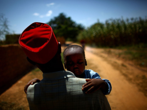 Ado Ibrahim carries his son Aminu through a village in northern Nigeria. Aminu was paralyzed by polio in August. Photo: David Gilkey / NPR At Polio's Epicenter, Vaccinators Battle Chaos And Indifference : Shots - Health News  Northern Nigeria is the only region in the world where the number of polio cases is on the rise. International groups have poured money and volunteers into the area to combat the disease. But vaccinators face daunting challenges — from security threats like terrorist bombings to a lack of basic resources like electricity.